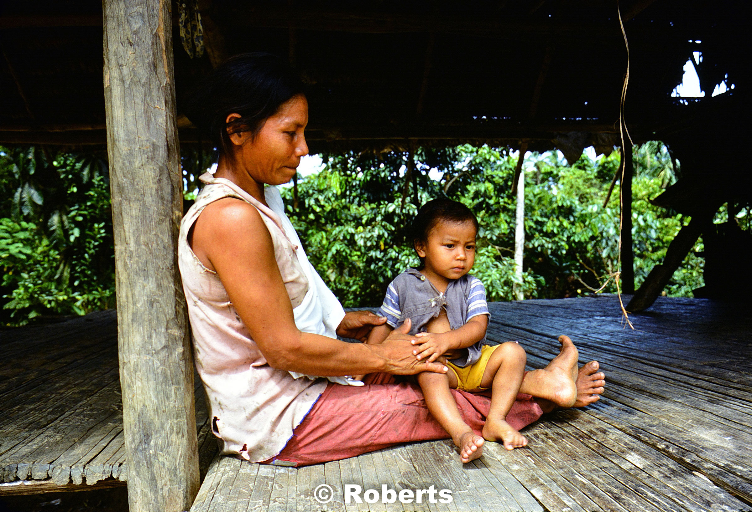 Proud mother and infant son. Upper Amazon River Basin, Peru. June, 1977.