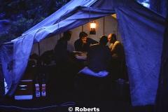 Poker game by lantern light. (L to R): Gary Walters, Art Brooks, Roy Sneed, and Bob Liveoak. Above Yosemite Falls, Yosemite National Park, California. June, 1974.